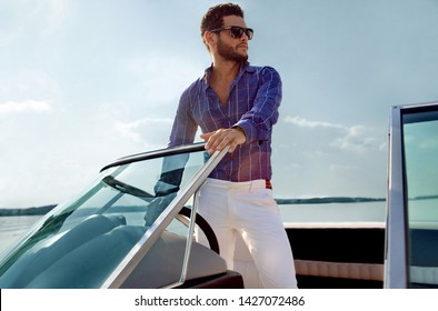 Sailing man on yacht in ocean,  sail