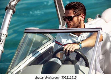 Sailing man on yacht in ocean