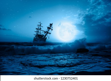 "Sailing old ship in storm sea - Night sky with moon in the clouds ""Elements of this image furnished by NASA"