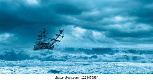 Sailing old ship in a storm sea on the background stormy clouds