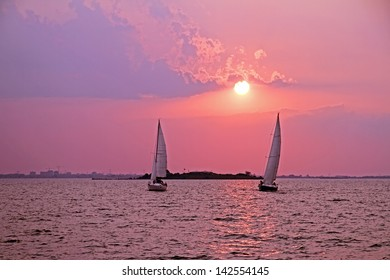 Sailing on the IJsselmeer in the Netherlands at sunset
