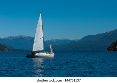 Sailing, on a lake in the Patagonian Andes.
