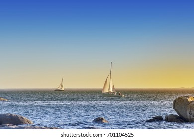 Sailing on the wind in Arousa Island at sunset