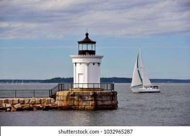 Sailing Past Portland Breakwater Lighthouse in Maine, on a warm summer day.