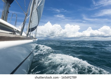 sailing/ a pleasure yacht under full sail in Fiji, shot from the starboard side towards the bow