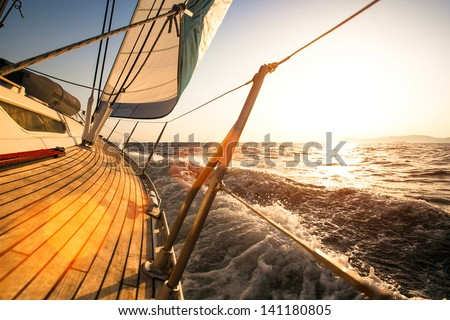 Sailing regatta, during sunset.