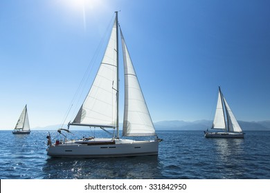 Sailing regatta. Sailing in the wind through the waves. Luxury yachts.