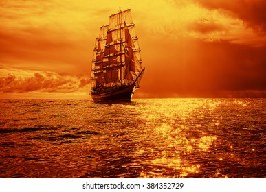 Sailing ship in a beautiful golden sunset.  Instagram effect. Sailing. Yachting
