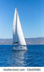 Sailing ship boats with white sails in the Sea. Luxury yachts.