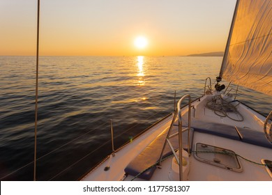Sailing ship luxury yacht boat in the Sea during amazing sunset