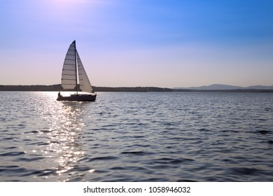 A sailing ship on the background of beautiful sunset
