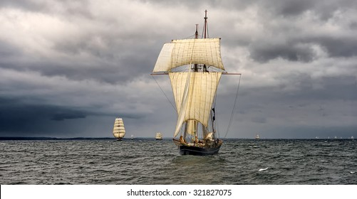 Sailing ship on the background of stormy sky. Yachting. Sail. Tall ships