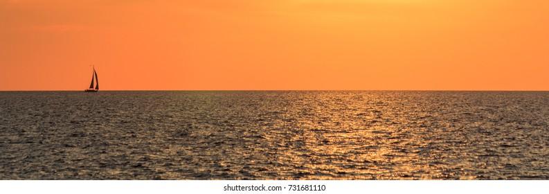 Sailing ship on horizon