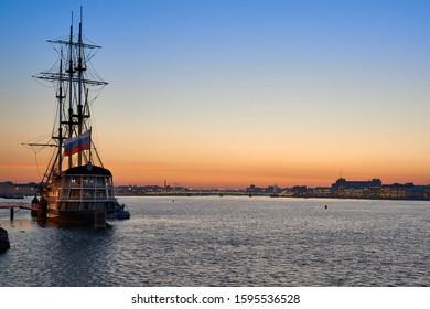 Sailing ship on Neva river embankment in Saint-Petersburg on sunrise