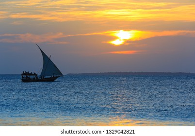 sailing ship on sea on sunset background