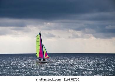 Sailing ship at sea on a cloudy day
