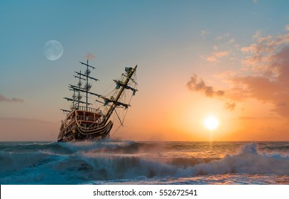 Sailing ship in storm sea against heavy sunset clouds
