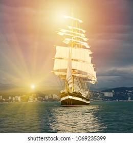 Sailing ship and sun rays. Yachting. Sailing. Race