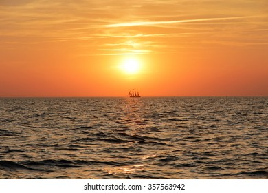Sailing ship in Sunset on the sea in summer