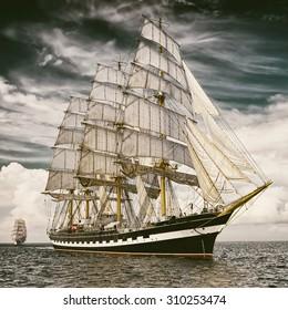 Sailing ship.  Toned image and blur. Retro style postcard. Sailing. Yachting. Travel