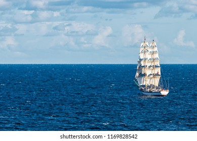 A sailing ship under full sailings on the sea