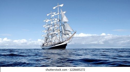 Sailing ship under white sails
