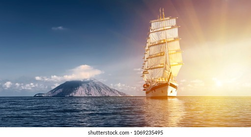 Sailing ship with white sails in the sea.  Cruise. Sailing. Yachting