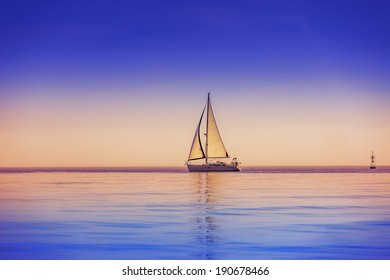 Sailing ship yachts and deep blue sky