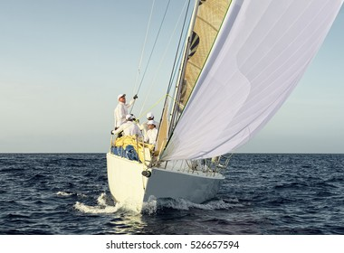 Sailing ship yachts with white sails. Yachting