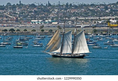 Sailing ships and boats in harbor near the airport