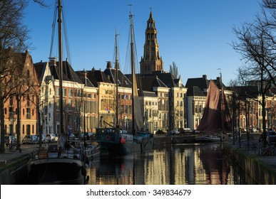 Sailing ships in a canal in the city center of Groningen, Holland.