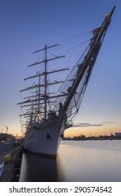 sailing ships moored at the wharf