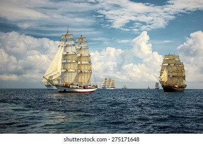 Sailing ships on a background of beautiful sky and sea