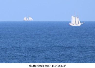 Sailing ships on the horizon