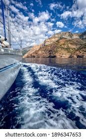 Sailing at the South of Ikaria island, Greece, with a sailboat