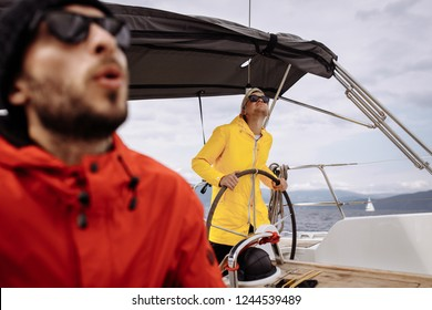 Sailing sport. Capitain at the helm. Man at the helm. Wind in the hair. Regatta and race. Dream team