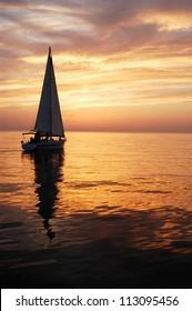 sailing in sun set
