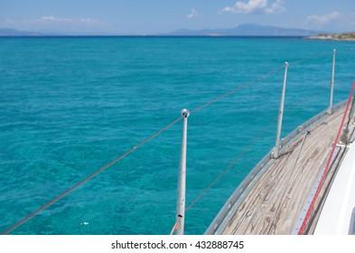 Sailing in turquoise sea of Vagia, Aegina island, Greece.