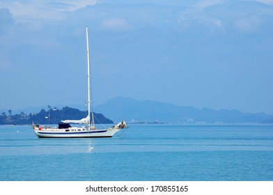 Sailing yacht in blue sea