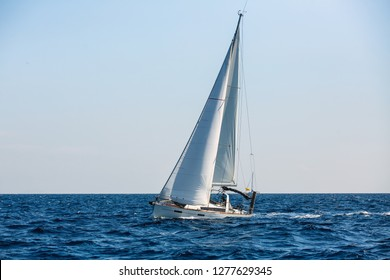Sailing yacht boat in the Aegean sea. Luxury vacation.
