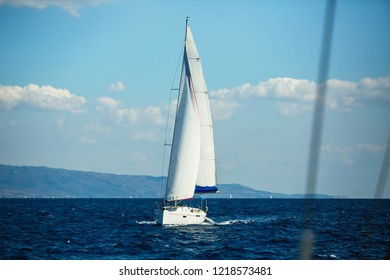 Sailing yacht boat glides on the Sea.