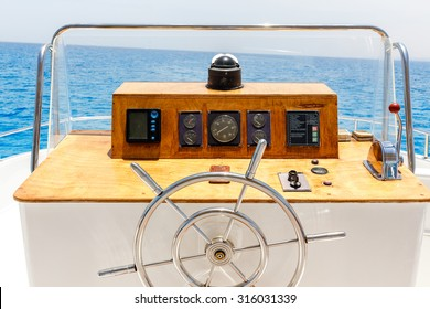 Sailing yacht control wheel and navigation implement. Horizontal shot without people