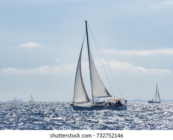 Sailing yacht in Croatia, windy summer on the boat between rocky islands of the Mediterranean sea
