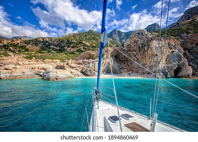 Sailing yacht lying at the beach of Seychelles, with transparent turquoise waters, in Ikaria island, Greece