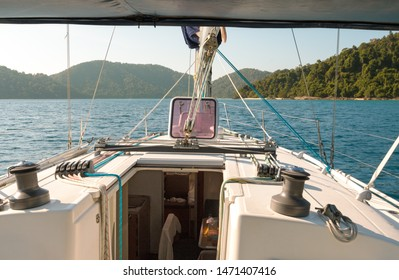 Sailing yacht near Similan island. Beautiful tropical nature, calm warm blue sea - real paradise. Holiday vacation in cruise on sailing yacht in Andaman sea of Indian ocean, Thailand