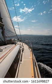 Sailing yacht on the mediterranean sea with sunshine and croatian coast in the background