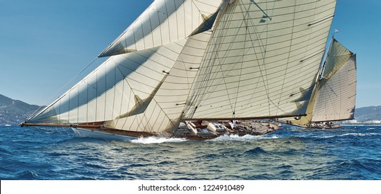 Sailing yacht race, regatta. Sail boat team athletes participating in the sailing competition. Recreational Water Sports. Extreme Sport Action. Healthy Active Lifestyle. Summer Fun Adventure