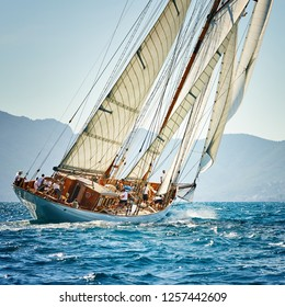 Sailing yacht race. Sailboat under white sails at the regatta