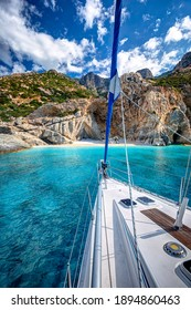 Sailing yacht relaxing at the beach of Seychelles, with transparent turquoise waters, in Ikaria island, Greece