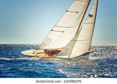 Sailing yacht. Sailboat under white sails at the regatta